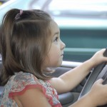 child actor driving a car